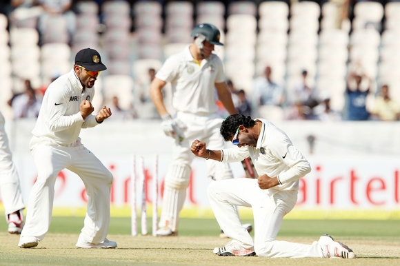 Virat Kohli and Ravindra Jadeja celebrate the wicket of Moises Henriques