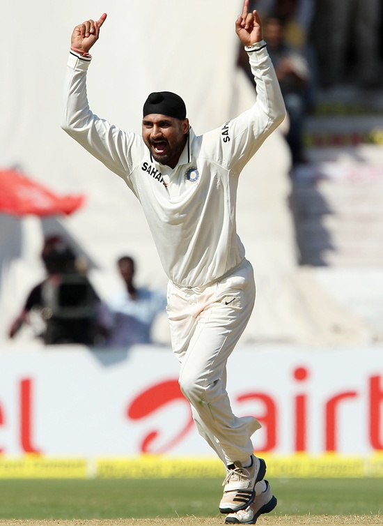 Harbhajan Singh of India celebrates the wicket of Matthew Wade