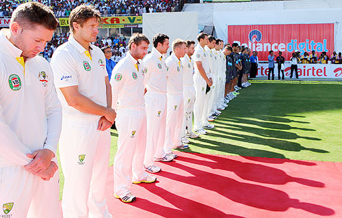 The Australian cricket team lines up for a minute's silence, before start of play on Day 2 on Sunday, to honour those injured in the explosions in Hyderabad last week