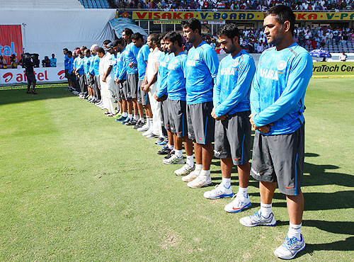 The Indian team lines up for a minute's silence, before start of play on Day 2 on Sunday, to honour those injured in the explosions in Hyderabad last week