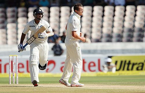 Murali Vijay steals a run past Peter Siddle