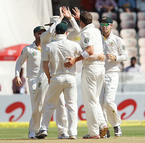 Peter Siddle celebrates the wicket of Virender Sehwag