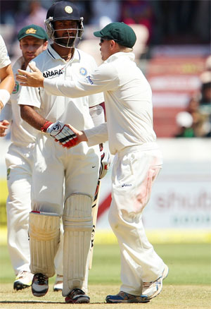 Cheteshwar Pujara is congratulated by David Warner after completing his double century on Monday