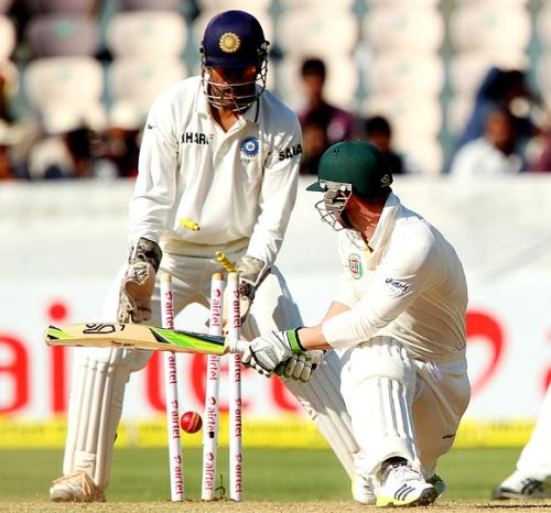 Phil Hughes is clean bowled by R Ashwin
