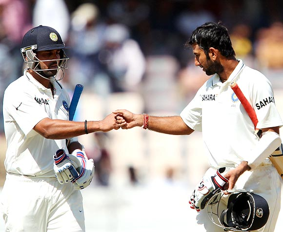 Cheteshwar Pujara (right) with Murali Vijay