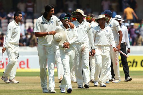 Indian players walk back after winning the Test