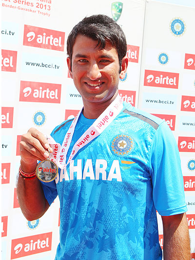 Cheteshwar Pujara is awarded the man-of-the-match on Tuesday