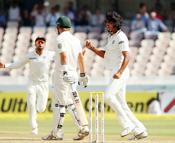 Ishant Sharma celebrates after bagging the wicket of Shane Watson