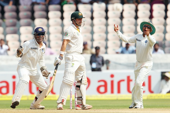 MS Dhoni and Virender Sehwag celebrate the wicket of Ed Cowan