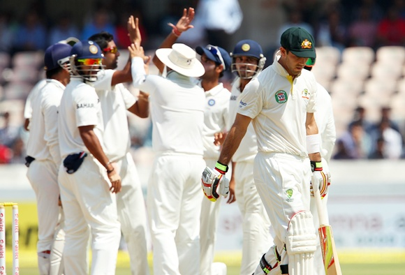 Indian players celebrate as Glenn Maxwell departs