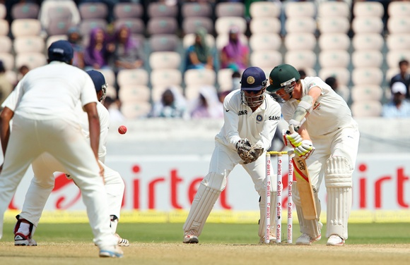 Wade edges one from Ashwin and is caught by Sehwag