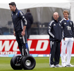 England cricket team player Kevin Pietersen (left) rides a Segway past teammates Jonathan Trott (centre) and Nick Compton