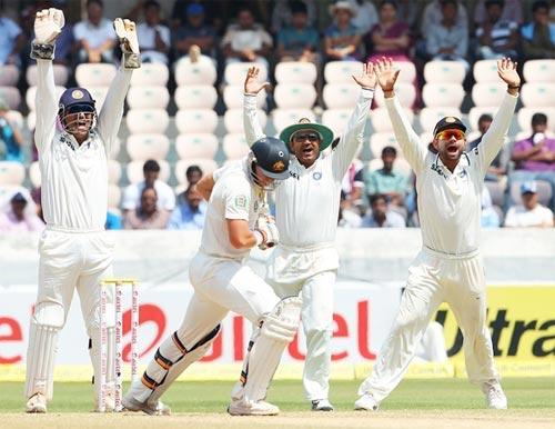 Indian players appeal for the wicket of James Pattinson