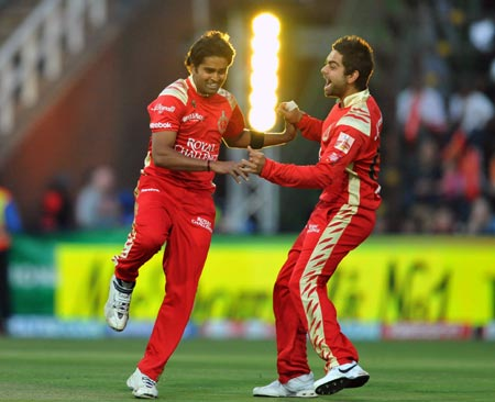 Royal Challengers Bangalore captain Virat Kohli (right) with team mate R Vinay Kumar