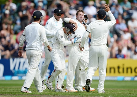 Bruce Martin celebrates with teammates after dismissing Matt Prior
