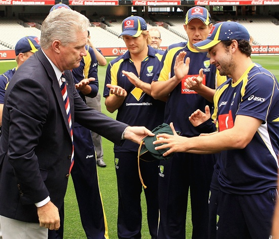 Ed Cowan of Australia is presented with his Baggy Green Cap by former cricketer Dean Jones