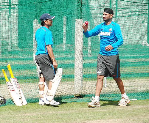 Sachin Tendulkar and Harbhajan Singh share notes at the nets