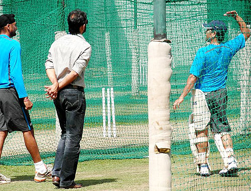 Sachin Tendulkar shares inputs with Harbhajan Singh at the nets on Wednesday