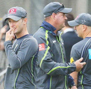 Australian captain Michael Clarke (left) looks on as coach Mickey Arthur talk