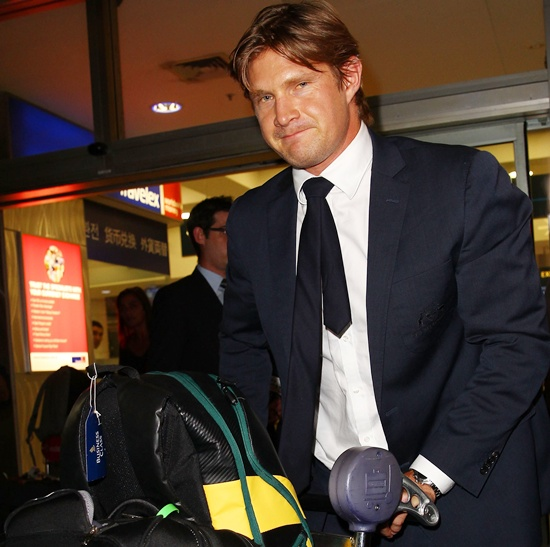 Shane Watson arrives at Sydney International Airport