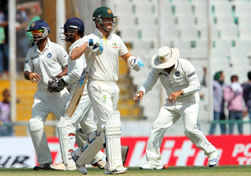 Michael Clarke walks back after being dismissed by Ravindra Jadeja