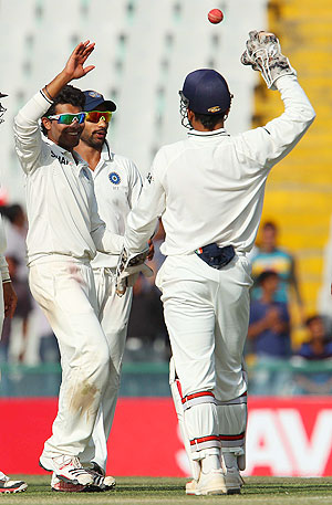 Jadeja is congratulated by teammates after the dismissal of Peter Siddle