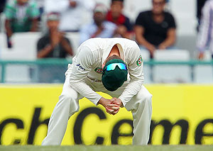 Michael Clarke Captain of Australia looks to the ground after Shikhar Dhawan of India edges one to the boundary
