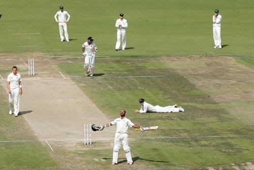 Shikhar Dhawan celebrates after reaching his century