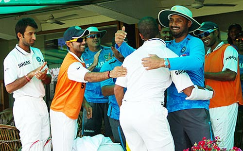 Shikhar Dhawan is congratulated by team mates