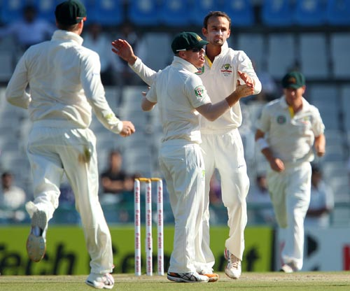 Nathan Lyon celebrates after dismissing Shikhar Dhawan