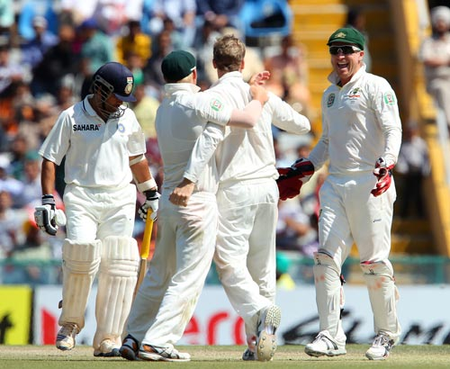 Australian players celebrate after getting the wicket of Sachin Tendulkar