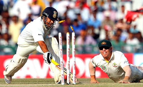 David Warner of Australia runs out Sachin Tendulkar of India