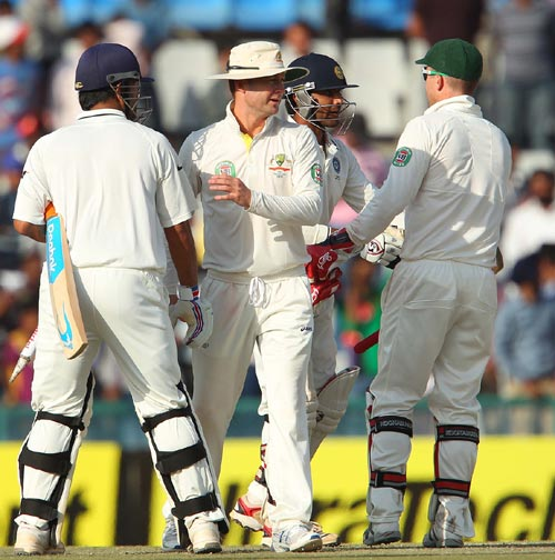 Michael Clarke shakes hand with MS Dhoni after the Mohali Test
