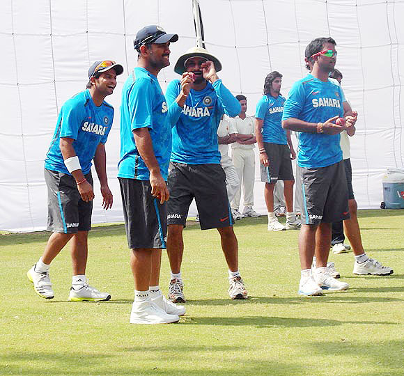Harbhajan Singh jokes with captain Mahendra Singh and other players