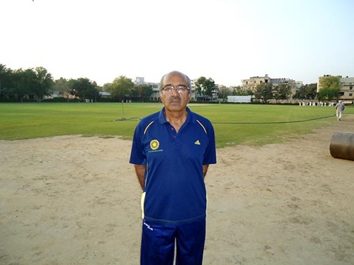 AN Sharma stands next to the pitch where Sehwag started playing as a kid