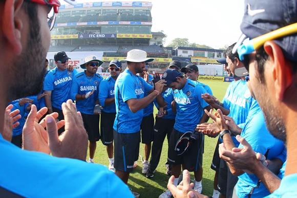 Ajinkya Rahane receives his Test cap from Harbhajan Singh