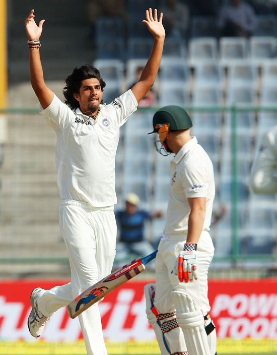 Ishant Sharma celebrates the dismissal of David Warner