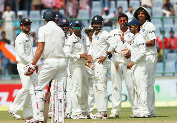 Murali Vijay gestures to Mitchell Johnson to leave the field