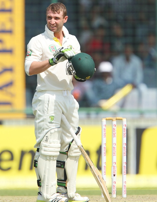 Phillip Hughes examines his helmet after being hit