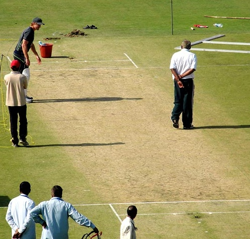 Shane Watson inspects the pitch ahead of the Test