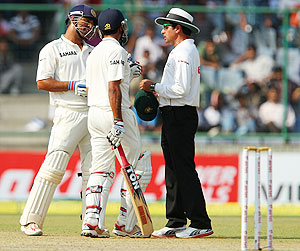 Dhoni and Jadeja speak to umpire Aleem Dar