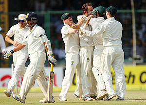 Nathan Lyon celebrates with teammates after dismissing Sachin Tendulkar on Day 2 of the 4th Test at the Feroz Shah Kotla stadium in Delhi on Saturday