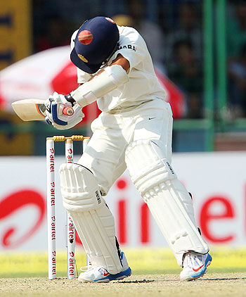 Ajinkya Rahane gets knocked in the head off a short delivery during his innings on Day 2