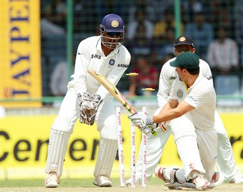Ed Cowan is clean bowled by Ashwin