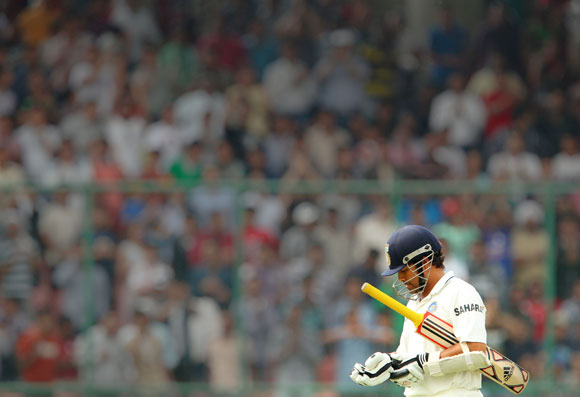 Sachin Tendulkar walks back to the pavilion