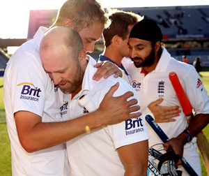 Matt Prior of England is hugged by Stuart Broad