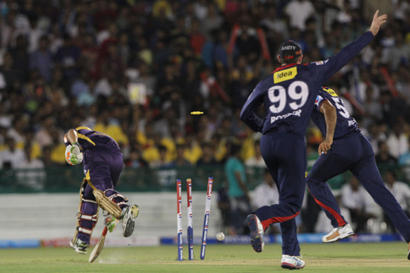 Irfan Pathan of Delhi Daredevils celebrates after running out Kolkata Knight Riders captain Gautam Gambhir in the first over