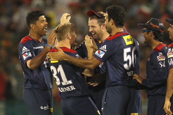 Umesh Yadav of Delhi Daredevils and David Warner of Delhi Daredevils congratulate Ben Rohrer of Delhi Daredevils for taking the catch to get Jacques Kallis of Kolkata Knight Riders wicket off Irfan Pathan