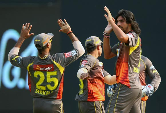 Ishant Sharma celebrates with team mates after getting the wicket of Dinesh Karthik