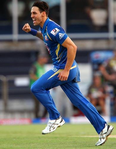 Mitchell Johnson celebrates the wicket of Akshath Reddy